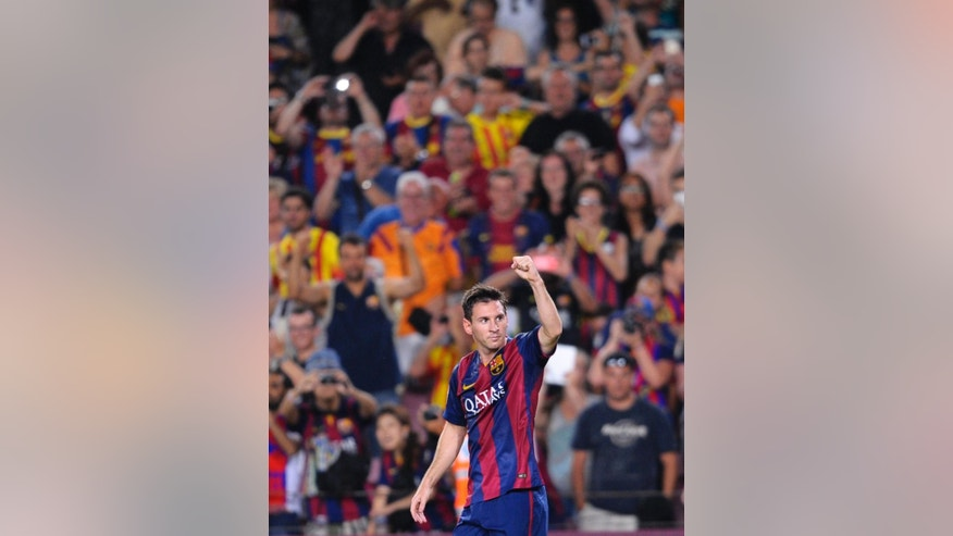 FC Barcelona's Lionel Messi, from Argentina, reacts after scoring against Elche during a Spanish La Liga soccer match at the Camp Nou stadium in Barcelona, Spain, Sunday, Aug. 24, 2014. (AP Photo/Manu Fernandez)