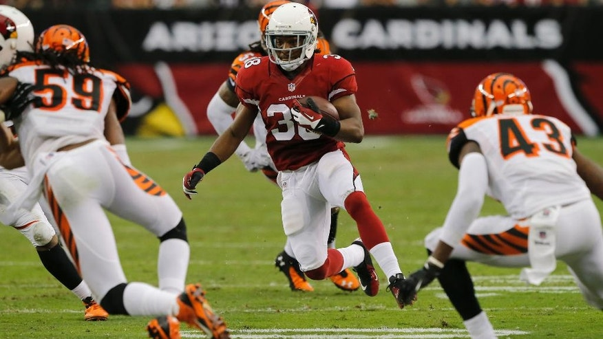 Arizona Cardinals running back Andre Ellington (38) looks for room to run as Cincinnati Bengals linebacker Emmanuel Lamur (59) and George Iloka (43) defend during the first half of an NFL preseason football game, Sunday, Aug. 24, 2014, in Glendale, Ariz. (AP Photo/Rick Scuteri)