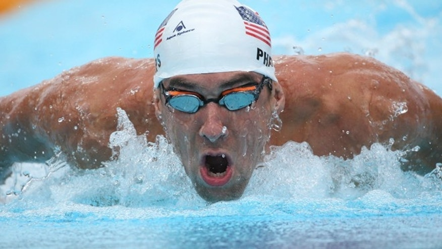 Aug. 24, 2014: Michael Phelps of the U.S.  swims butterfly during his men's 200m individual medley at the Pan Pacific swimming championships in Gold Coast, Australia. (AP)