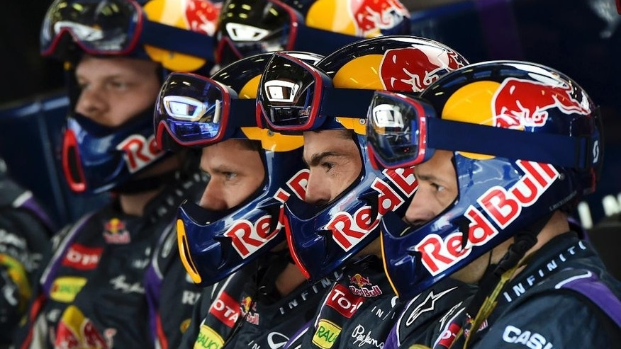 Red Bull mechanics look on a screen during the Belgium Formula One race at the Spa-Francorchamps circuit, Belgium, Sunday, Aug. 24, 2014. Red Bull driver Daniel Ricciardo won an incident-packed Belgian Grand Prix on Sunday, while Nico Rosberg was second to extend his championship lead over Mercedes teammate Lewis Hamilton in acrimonious circumstances. (AP Photo/ Ben Stansall , Pool)