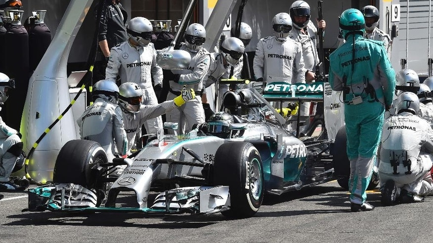 Mercedes driver Nico Rosberg of Germany gets a pit service during the Belgium Formula One race at the Spa-Francorchamps circuit, Belgium, Sunday, Aug. 24, 2014.Red Bull driver Daniel Ricciardo won an incident-packed Belgian Grand Prix on Sunday, while Nico Rosberg was second to extend his championship lead over Mercedes teammate Lewis Hamilton in acrimonious circumstances. (AP Photo/ Ben Stansall , Pool)