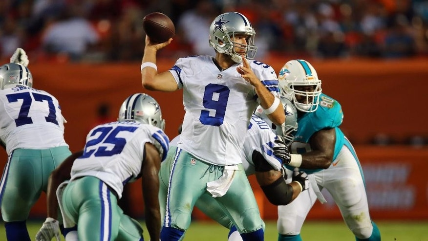 Dallas Cowboys quarterback Tony Romo (9) looks to pass during the first half of an NFL preseason football game against the Miami Dolphins, Saturday, Aug. 23, 2014, in Miami Gardens, Fla. (AP Photo/J Pat Carter)