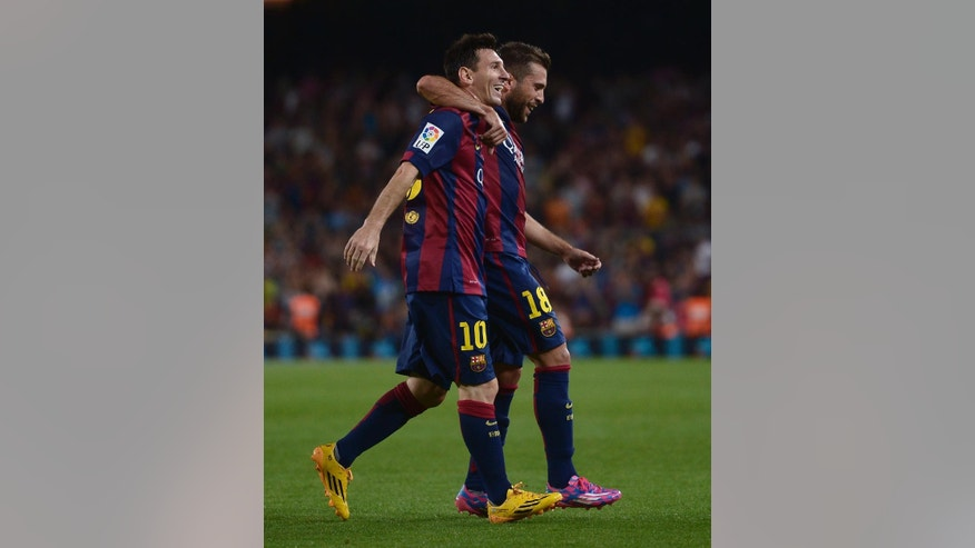 FC Barcelona's Lionel Messi from Argentina, left, reacts after scoring with his teammate Jordi Alba against Elche during a Spanish La Liga soccer match at the Camp Nou stadium in Barcelona, Spain, Sunday, Aug. 24, 2014. (AP Photo/Manu Fernandez)