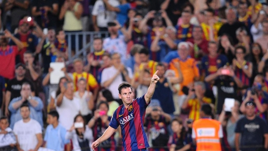 FC Barcelona's Lionel Messi from Argentina reacts after scoring against Elche during a Spanish La Liga soccer match at the Camp Nou stadium in Barcelona, Spain, Sunday, Aug. 24, 2014. (AP Photo/Manu Fernandez)