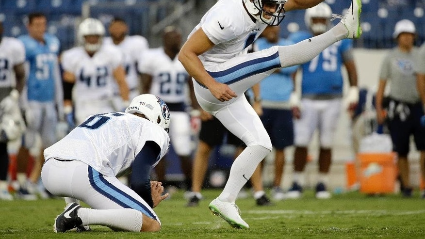 FILE -- In this Aug. 2, 2014, file photo, Tennessee Titans kicker Travis Coons, right, kicks a field goal during NFL football training camp practice in LP Field in Nashville, Tenn. The competition to be Tennessee's kicker this season remains wide open and close, and head coach Ken Whisenhunt says he's letting both Coons and Maikon Bonani keep kicking through Thursday night's preseason finale. (AP Photo/Mark Humphrey, File)