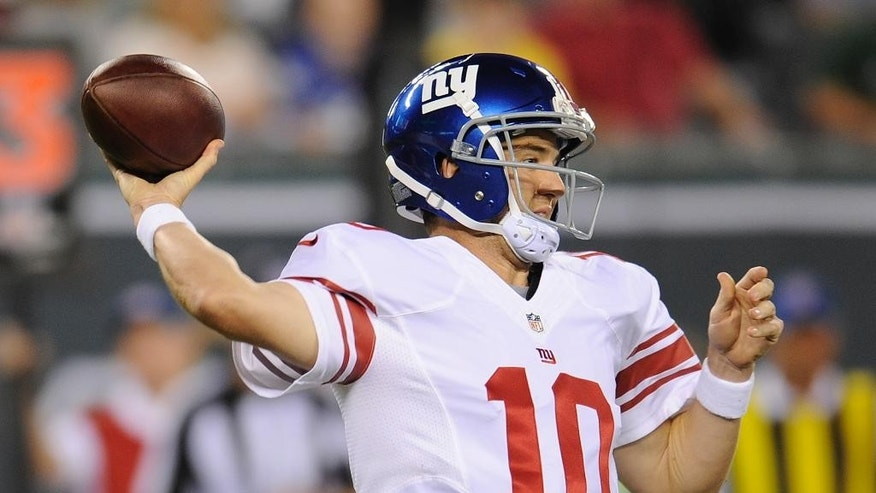 New York Giants quarterback Eli Manning (10) throws against the New York Jets in the first quarter of a preseason NFL football game, Friday, Aug. 22, 2014, in East Rutherford, N.J. (AP Photo/Bill Kostroun)