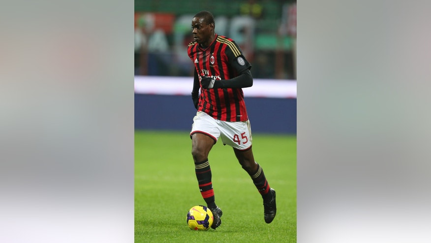 "In this picture taken  Saturday, Nov. 23, 2013, AC Milan forward Mario Balotelli controls the ball during a Serie A soccer match between AC Milan and Genoa, at the San Siro stadium in Milan, Italy. Liverpool could be about to replace one controversial striker with another.  Italy international Mario Balotelli has been lined up by the Premier League club as a potential replacement for Luis Suarez, who left Anfield to join Barcelona for $130 million. Balotelli, who spent 2½ years with Manchester City up to 2013, left the club's Milanello training ground on Thursday, Aug. 21, 2014, for possibly the last time. ""Mario Balotelli left Milanello's sporting center at 1330 (local time) after saying goodbye to his teammates,"" Milan said in a statement. ""Before going through the gates, he said goodbye to members of Milan's press office."" (AP Photo/Luca Bruno)"