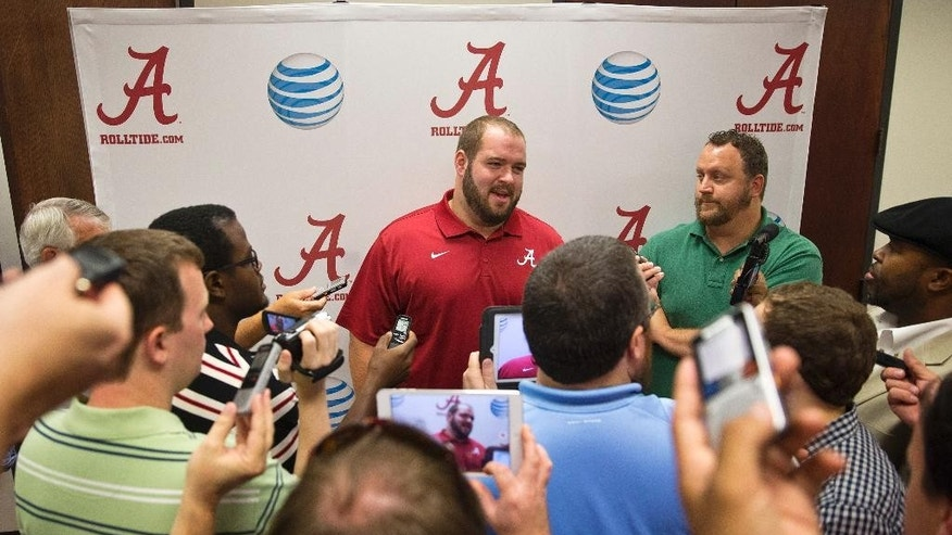 Alabama offensive linesman Austin Shepherd (79), center, speaks to the media during an NCAA college football press conference on Monday, Aug. 25, 2014, in Tuscaloosa, Ala.(AP Photo/Brynn Anderson)