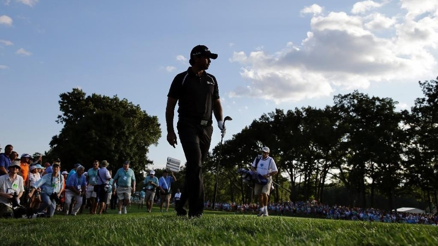 Jason Day, of Australia, walks to the 18th hole during the final round of play at The Barclays golf tournament Sunday, Aug. 24, 2014, in Paramus, N.J. Hunter Mahan won the tournament with a 14 under-par 270.   (AP Photo/Mel Evans)
