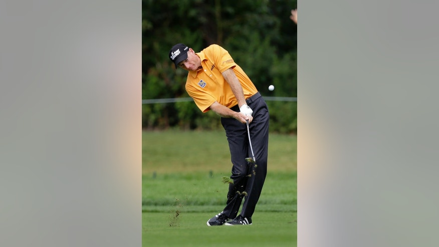 Jim Furyk hits a fairway shot on the first hole during the third round of play at The Barclays golf tournament Saturday, Aug. 23, 2014, in Paramus, N.J. (AP Photo/Mel Evans)