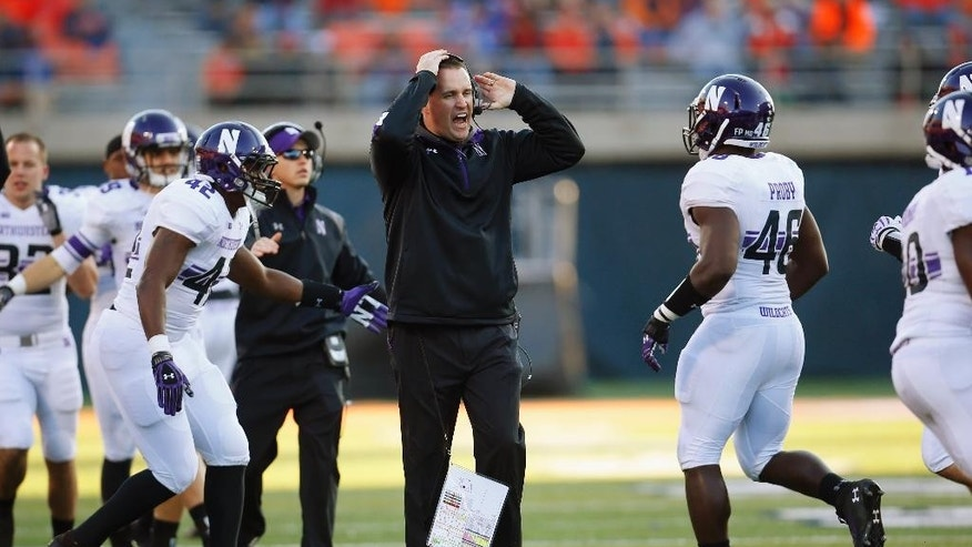 FILE - In this Nov. 30, 2013, file photo, Northwestern head coach Pat Fitzgerald yells at his team during an NCAA college football game against Illinois in Champaign, Ill. The Wildcats are coming off a disappointing 5-7 season and already hit hard by injuries and a key defection ahead of the Saturday, Aug. 30, 2014, opener at home against Cal. On top of that, they spent the offseason at ground zero in the debate over whether college players should have the right to unionize. (AP Photo/Jeff Haynes, File)