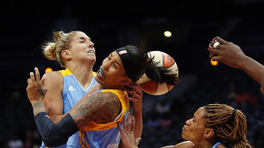 Chicago Sky guard/forward Elena Delle Donne, left, and forward Tamera Young (1) battle Atlanta Dream guard Jasmine Thomas,  right, for a rebound  in the first half of Game 3 of the WNBA basketball Eastern Conference semifinals, Tuesday, Aug. 26, 2014, in Atlanta. Chicago won 81-80. (AP Photo/John Bazemore)