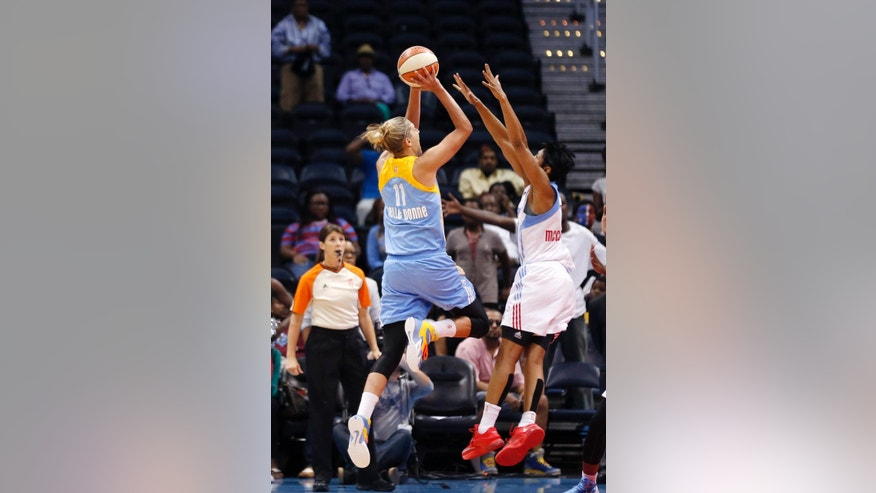 Chicago Sky guard/forward Elena Delle Donne (11) scores the game-winning basket against Atlanta Dream guard/forward Angel McCoughtry (35)  in the final second of the second  half of Game 3 of the WNBA basketball Eastern Conference semifinals, Tuesday, Aug. 26, 2014, in Atlanta. Chicago won 81-80. (AP Photo/John Bazemore)