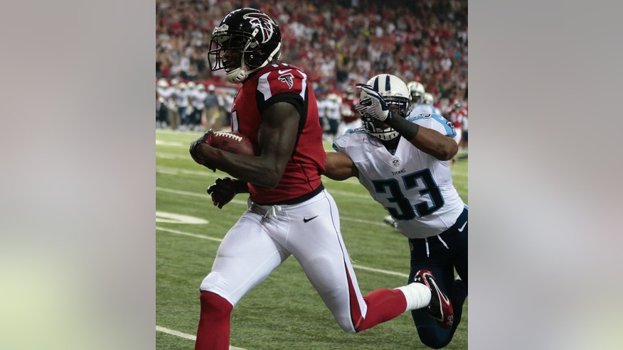 Atlanta Falcons wide receiver Julio Jones (11) runs into the end zone against Tennessee Titans free safety Michael Griffin (33) during the first half of an NFL preseason football game, Saturday, Aug. 23, 2014, in Atlanta. (AP Photo/John Bazemore)