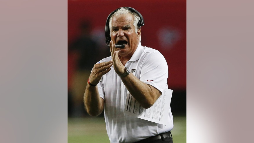 Atlanta Falcons head coach Mike Smith calls for time out against the Tennessee Titans during the first half of an NFL preseason football game, Saturday, Aug. 23, 2014, in Atlanta. (AP Photo/John Bazemore)