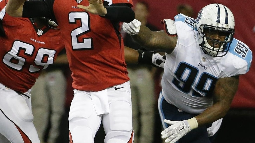 Atlanta Falcons quarterback Matt Ryan (2) passes the ball under pressure from Tennessee Titans defensive tackle Jurrell Casey (99) during the second half of an NFL preseason football game, Saturday, Aug. 23, 2014, in Atlanta. (AP Photo/David Goldman)