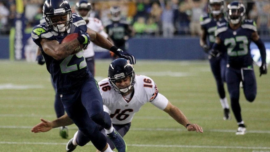 Seattle Seahawks' Earl Thomas, left, returns a punt as Chicago Bears punter Pat O'Donnell makes a touchdown-saving tackle in the first half of an preseason NFL football game, Friday, Aug. 22, 2014, in Seattle. (AP Photo/Stephen Brashear)