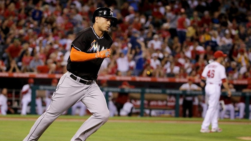 Miami Marlins' Giancarlo Stanton rounds the bases on a three-run home run against the Los Angeles Angels during the fourth inning of a baseball game in Anaheim, Calif., Monday, Aug. 25, 2014. (AP Photo/Chris Carlson)