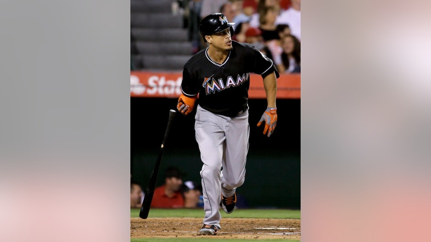 Miami Marlins' Giancarlo Stanton watches his three-run home run against the Los Angeles Angels during the fourth inning of a baseball game in Anaheim, Calif., Monday, Aug. 25, 2014. (AP Photo/Chris Carlson)