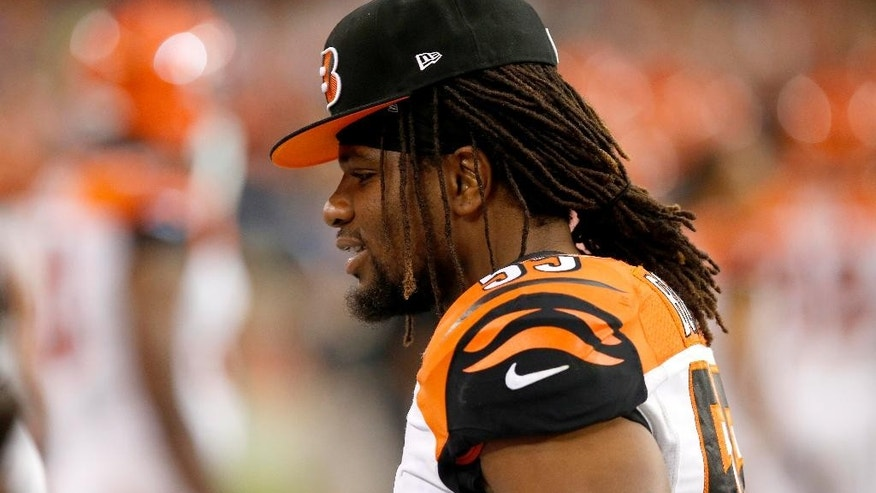 Cincinnati Bengals outside linebacker Vontaze Burfict sits on the bench after coming out of the game during the first half of an NFL preseason football game against the Arizona Cardinals, Sunday, Aug. 24, 2014, in Glendale, Ariz. (AP Photo/Ross D. Franklin)