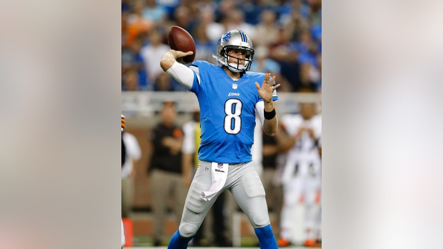 FILE - In this Aug. 9, 2014, file photo, Detroit Lions quarterback Dan Orlovsky throws against the Cleveland Browns in a preseason NFL football game at Ford Field in Detroit. Orlovsky, who was a part of Detroit's 0-16 team in 2008, is back with the Lions as the No. 2 quarterback behind Matthew Stafford. (AP Photo/Rick Osentoski)