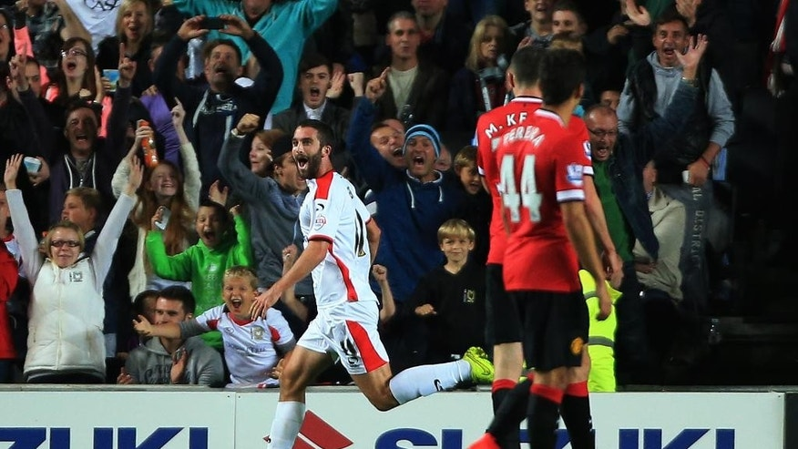 MK Dons' Will Grigg  jubilates after scoring a second goal against Manchester United during the League Cup Second Round match at Stadium:mk, Milton Keynes, England, Tuesday Aug. 26, 2014. MK Dons defeated Manchester United 4-0. (AP Photo/PA, Nick Potts) UNITED KINGDOM OUT  NO SALES  NO ARCHIVE