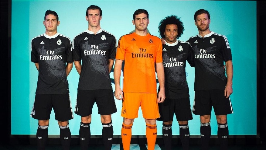 From left, Real's James Rodriguez, Gareth Bale, goalkeeper Iker Casillas, Marcelo and Xabi Alonso pose for the photographers during the presentation of the Real Madrid's new Champions League kit at the Santiago Bernabeu stadium in Madrid, Spain, Tuesday, Aug. 26, 2014. (AP Photo/Andres Kudacki)