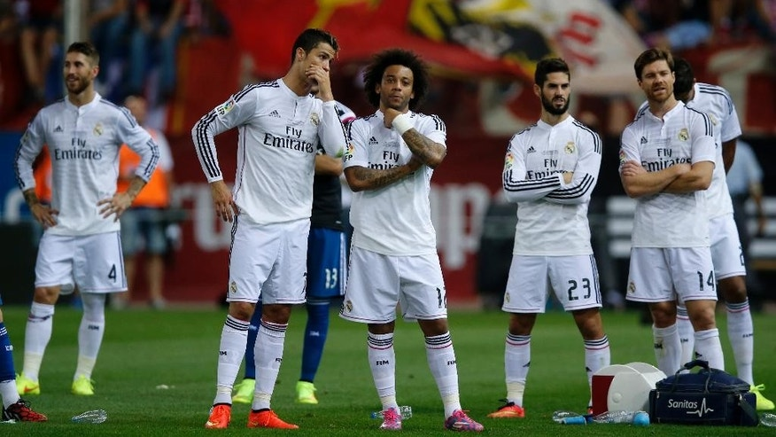 From left: Real Madrid Sergio Ramos, Cristiano Ronaldo, Marcelo from Brazil, Isco, and Xabi Alonso react after loosing the Spanish Super Cup soccer match against Atletico Madrid at the Vicente Calderon stadium in Madrid, Spain, Friday, Aug. 22, 2014 . (AP Photo/Daniel Ochoa de Olza)