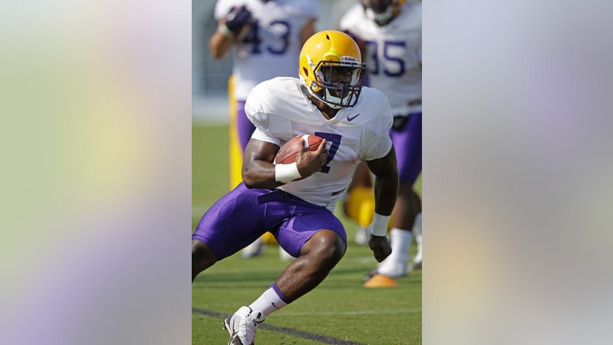 FILE - In this Aug. 6, 2014, file photo, LSU freshman running back Leonard Fournette (7) runs through drills during an NCAA college football practice in Baton Rouge, La. Fournette headlines another promising group looking to make an immediate impact.  (AP Photo/Gerald Herbert, File)