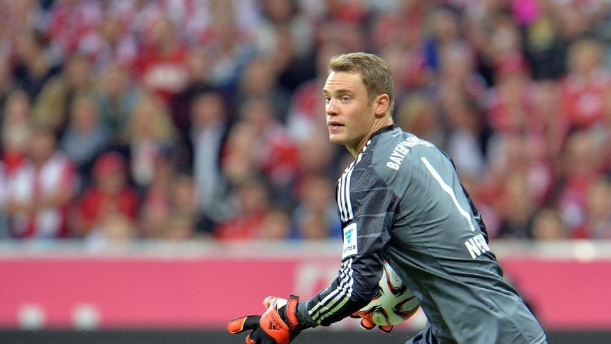 Bayern's goalkeeper Manuel Neuer in action during the  soccer match between FC Bayern Munich and VfL Wolfsburg in the Allianz Arena in Munich, Germany, on Friday, Aug. 22, 2014. (AP Photo/Kerstin Joensson)