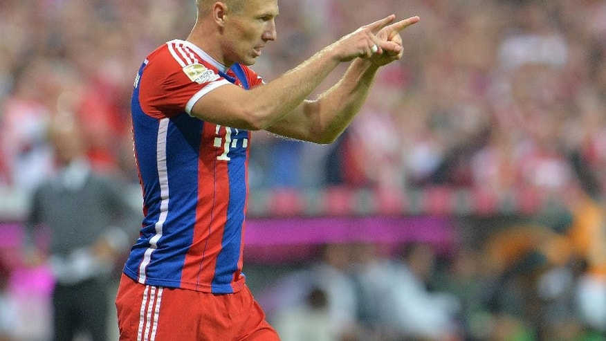 Bayern's Arjen Robben from the Netherlands celebrates after scoring during the  soccer match between FC Bayern Munich and VfL Wolfsburg in the Allianz Arena in Munich, Germany, on Friday, Aug. 22, 2014. (AP Photo/Kerstin Joensson)