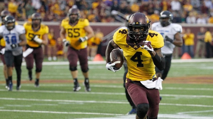 Minnesota wide receiver Donovahn Jones (4) runs into the end zone for a touchdown on a 35-yard pass from quarterback Mitch Leidner during the second quarter of an NCAA college football game against Eastern Illinois in Minneapolis Thursday, Aug. 28, 2014. (AP Photo/Ann Heisenfelt)
