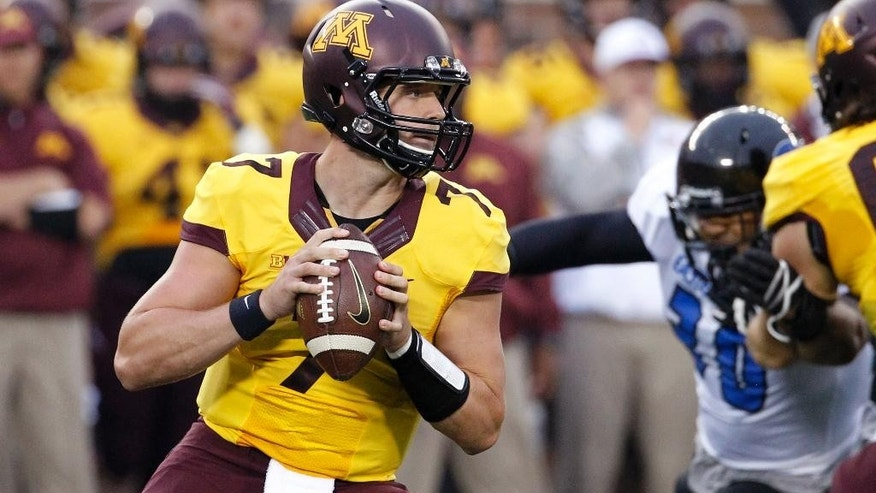 Minnesota quarterback Mitch Leidner (7) drops back for a pass against  Eastern Illinois during the first quarter of an NCAA college football game in Minneapolis Thursday, Aug. 28, 2014. (AP Photo/Ann Heisenfelt)