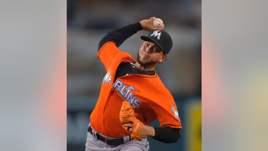 Miami Marlins starting pitcher Henderson Alvarez throws to the plate during the first inning of a baseball game against the Los Angeles Angels, Wednesday, Aug. 27, 2014, in Anaheim, Calif. (AP Photo/Mark J. Terrill)