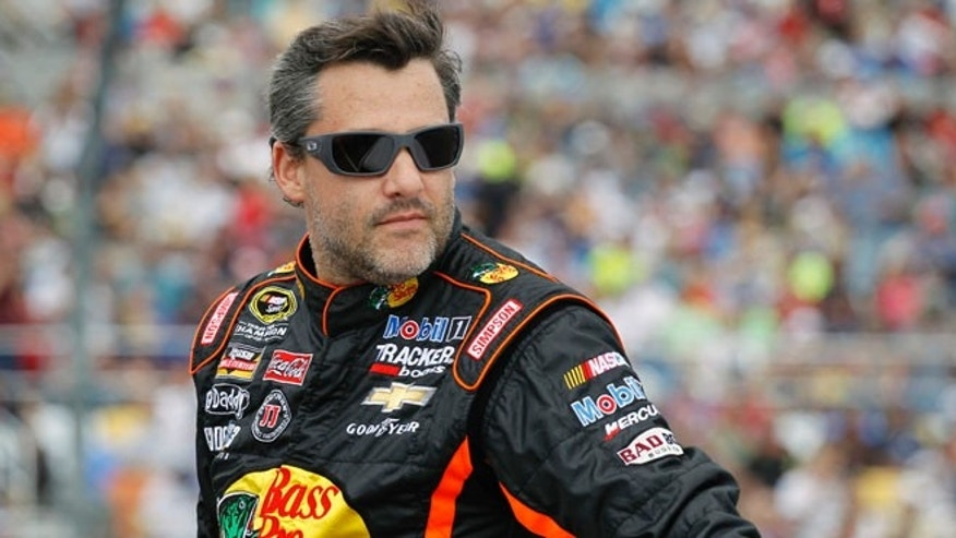 Feb. 23, 2014: Tony Stewart is introduced before the NASCAR Daytona 500 Sprint Cup series auto race at Daytona International Speedway in Daytona Beach, Fla.