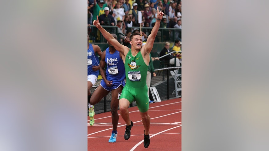 FILE - In this June 14, 2014, file photo, Oregon's Devon Allen celebrates after winning the men's 110-meter hurdles at the NCAA track and field championships, in Eugene, Ore. In June, Allen won the NCAA championship in the 110-meter hurdles. Two months later, he's won the job a starting receiver for the No. 3 Ducks. Allen, a redshirt freshman, will start along with senior Keanon Lowe at receiver when Oregon hosts South Dakota in the opener on Saturday night. (AP Photo/Rick Bowmer, File)