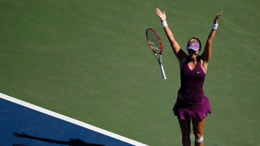 Mirjana Lucic-Baroni, of Croatia, reacts after defeating Simona Halep, of Romania, during the third round of the 2014 U.S. Open tennis tournament, Friday, Aug. 29, 2014, in New York. (AP Photo/Elise Amendola)
