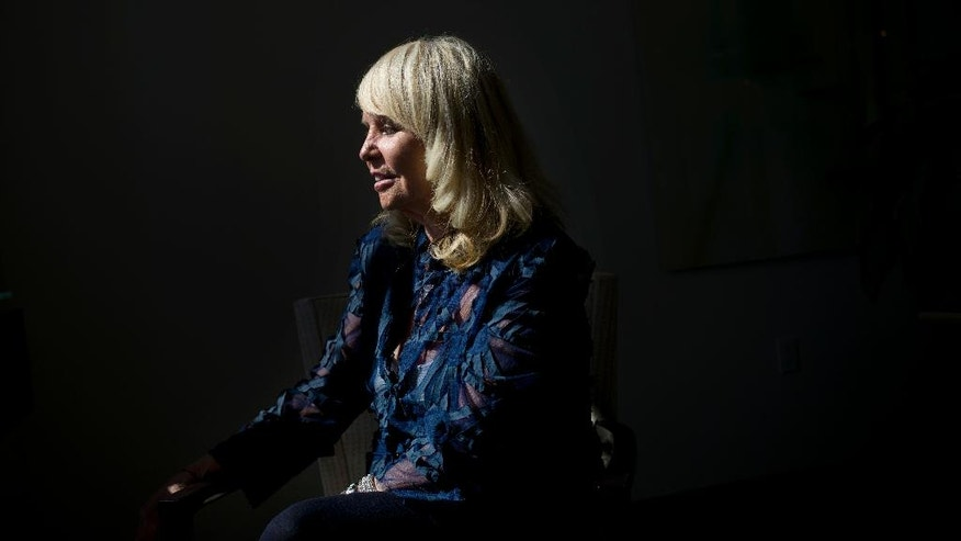 Shelly Sterling, wife of former Los Angeles Clippers owner Donald Sterling, pauses for photos after an interview with The Associated Press Thursday, Aug. 28, 2014, in Los Angeles. Shelly Sterling negotiated a landmark deal for $2 billion to sell the Clippers to Steve Ballmer, former CEO of Microsoft. (AP Photo/Jae C. Hong)