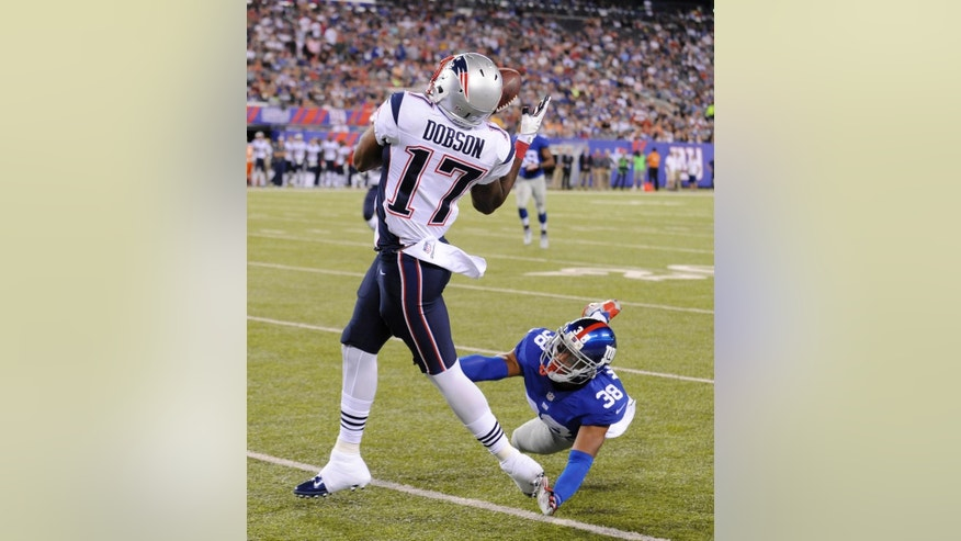 New England Patriots' Aaron Dobson, left, catches a touchdown pass while New York Giants' Trumaine McBride defends during the first half of an NFL preseason football game, Thursday, Aug. 28, 2014, in East Rutherford, N.J. (AP Photo/Bill Kostroun)