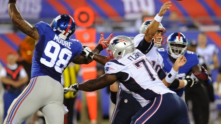 New England Patriots quarterback Jimmy Garoppolo, second from right, throws during the first half of an NFL preseason football game against the New York Giants, Thursday, Aug. 28, 2014, in East Rutherford, N.J. (AP Photo/Bill Kostroun)