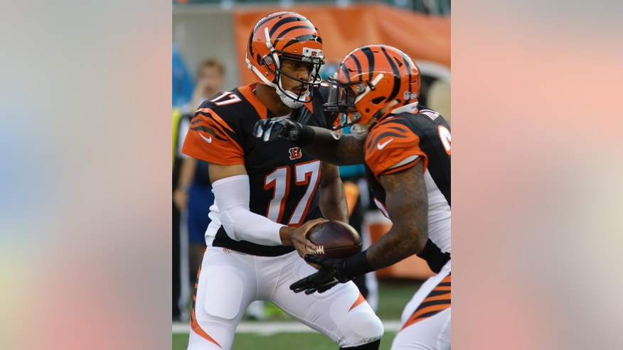 Cincinnati Bengals quarterback Jason Campbell (17) hands off to running back Jeremy Hill (32) in the first half of an NFL preseason football game against the Indianapolis Colts, Thursday, Aug. 28, 2014, in Cincinnati. (AP Photo/Tom Uhlman)