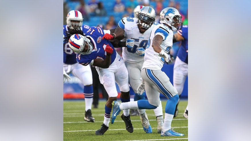 Buffalo Bills wide receiver Sammy Watkins (14) is hit by Detroit Lions outside linebacker Ashlee Palmer (58) during the first half of a preseason NFL football game, Thursday, Aug. 28, 2014, in Orchard Park, N.Y. (AP Photo/Bill Wippert)