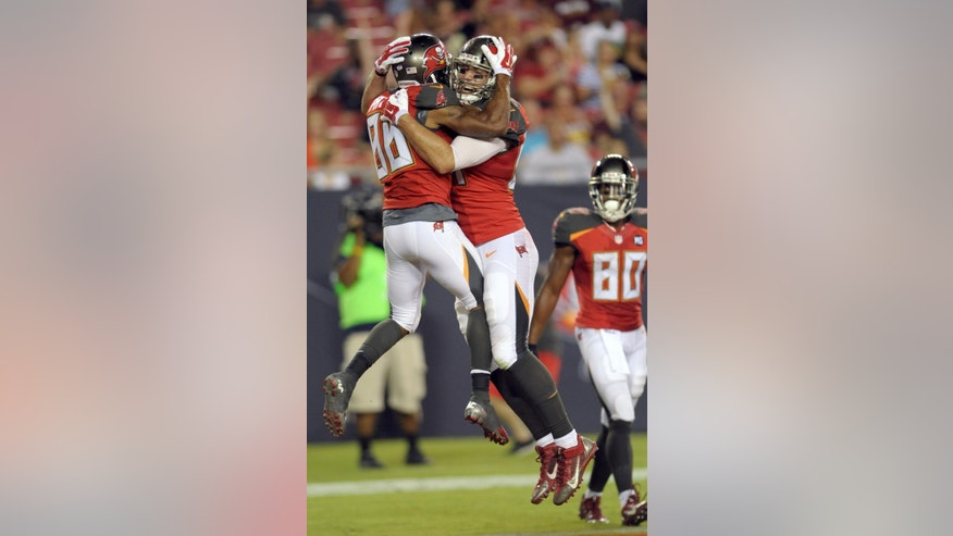 Tampa Bay Buccaneers wide receiver Solomon Patton (86) celebrates with tight end Cameron Brate after scoring a touchdown against the Washington Redskins  during the third quarter of an NFL preseason football game Thursday, Aug. 28, 2014, in Tampa, Fla. Tampa Bay's Chris Owusu (80) looks on. (AP Photo/Steve Nesius)