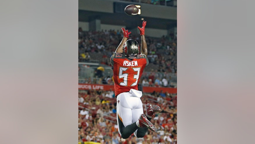 Tampa Bay Buccaneers linebacker Nate Askew (53) leaps to intercept a pass by Washington Redskins quarterback Colt McCoy during the second quarter of an NFL preseason football game Thursday, Aug. 28, 2014, in Tampa, Fla. (AP Photo/Brian Blanco)