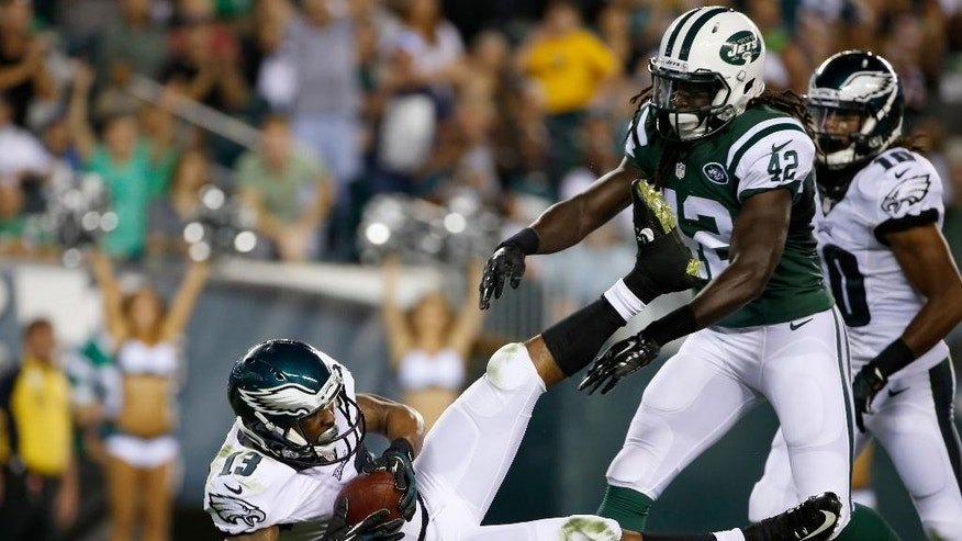 Philadelphia Eagles' Damaris Johnson, left, scores a touchdown past New York Jets' Brandon Dixon during the second half of an NFL preseason football game, Thursday, Aug. 28, 2014, in Philadelphia. (AP Photo/Michael Perez)