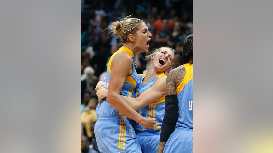 Chicago Sky's Elena Delle Donne (11), left, and guard Allie Quigley (14) celebrate after defeating the Atlanta Dream 81-80 in Game 3 of the WNBA basketball Eastern Conference semifinals, Tuesday, Aug. 26, 2014, in Atlanta. (AP Photo/John Bazemore)