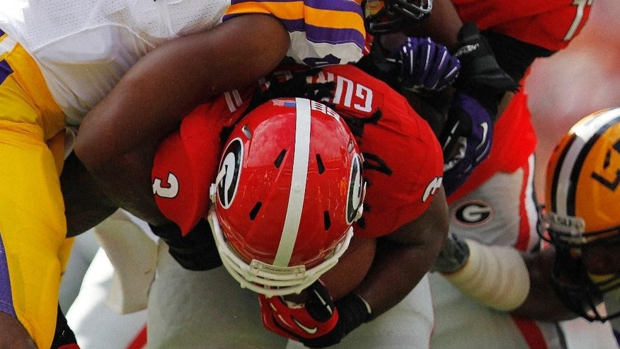 FILE - In this Sept. 28, 2013, file photo, Georgia running back Todd Gurley (3) is hit by LSU defensive end Danielle Hunter (94) during the first half of an NCAA college football game in Athens, Ga. When Hunter decided this summer that he would start trusting his instincts and stop overthinking things, he got off the snap quicker and began making life exceedingly difficult for Tigers offensive linemen in practice. (AP Photo/Mike Stewart, File)