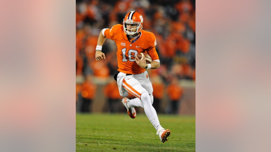"In this Nov. 14, 2013, photo, Clemson quarterback Cole Stoudt rushes for a touchdown against Georgia Tech during an NCAA college football game in Clemson, S.C. ""According to some of the guys, we're not going to get a first down,"" said Stoudt, who has the tough job of replacing three-year starter Tajh Boyd. ""I think people are going to be shocked by what we're going to do,"" he added. ""People are underestimating what we have, looking at all the negatives instead of the positives we have."" (AP Photo/Richard Shiro)"