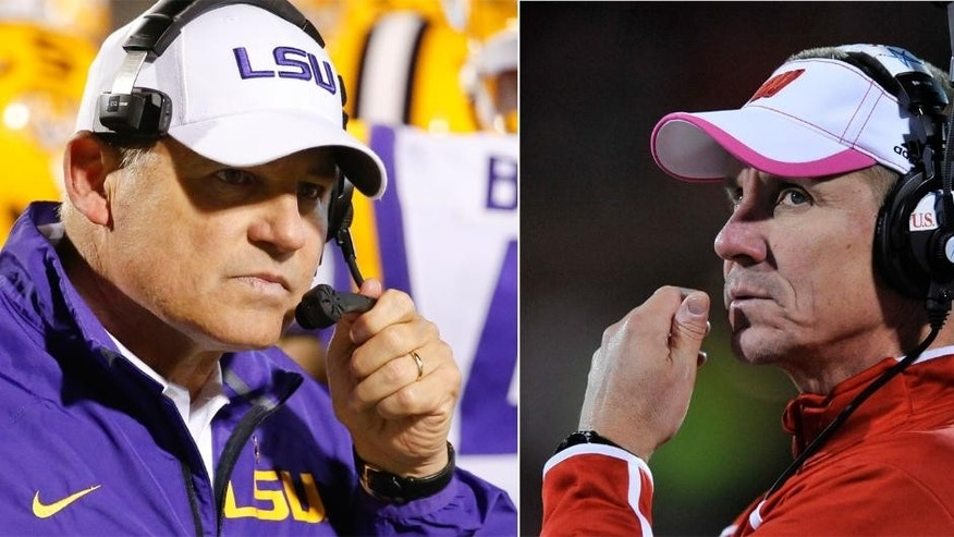FILE - At left in an Oct. 19, 2013, file photo, LSU football coach Les Miles is shown during the second half of an NCAA college football game against Mississippi in Oxford, Miss. At right, also in an Oct. 19, 2013, file photo, Wisconsin coach Gary Andersen watches during the fourth quarter of an NCAA college football game against Illinois in Champaign, Ill. One school has declared it will use two quarterbacks. The other hasn't officially named a starter behind center. Welcome to the coaching chess match before the high-profile season opener between No. 14 Wisconsin and No. 13 LSU. (AP Photo/File)