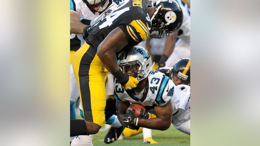 Pittsburgh Steelers linebacker Howard Jones (34), top, tackles Carolina Panthers running back Fozzy Whittaker (43) in the first quarter of the NFL preseason football game on Thursday, Aug. 28, 2014 in Pittsburgh. (AP Photo/Don Wright)
